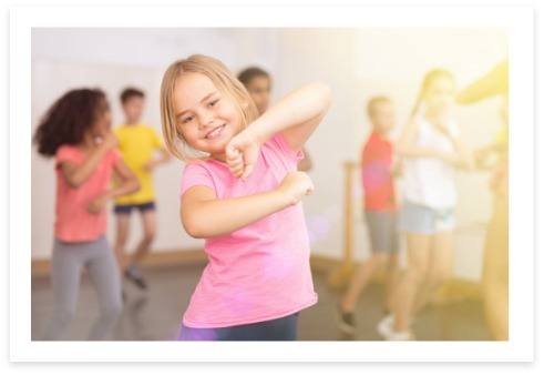 girl dancing dressed in pink